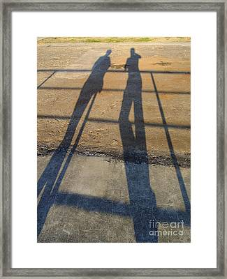 Shadows Of Two People Framed Print by Jannis Werner