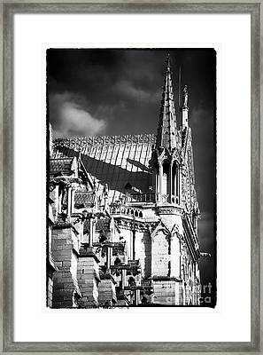 Shadows On Notre Dame Framed Print by John Rizzuto