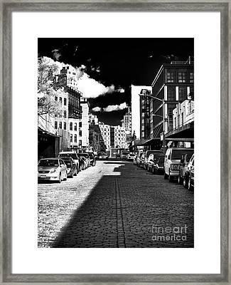 Shadows On The Street Framed Print by John Rizzuto