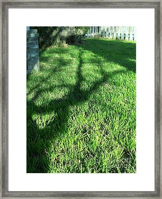 Shadows Reaching Framed Print