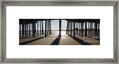 Shadows Under The Pier Framed Print