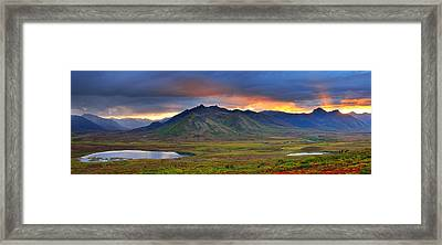 Shafts Of Sunlight Rising Above The Framed Print