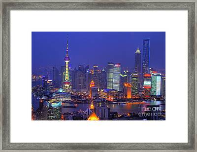 Shanghai's Skyline Framed Print by Lars Ruecker