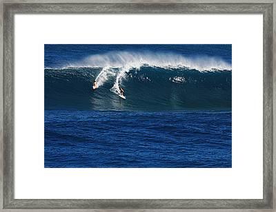 Sharing A Wave In Waimea Bay Framed Print