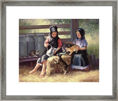 Sharing With A Friend Framed Print by Laurie Hein