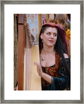 She Plays In Beauty Framed Print by Rodney Lee Williams