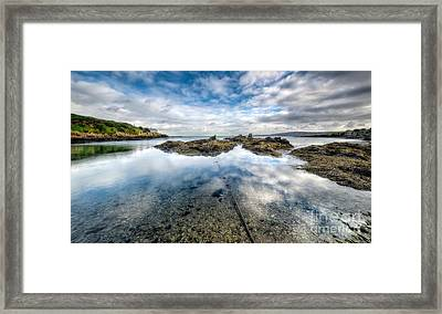 Sheltered Bay Framed Print by Adrian Evans