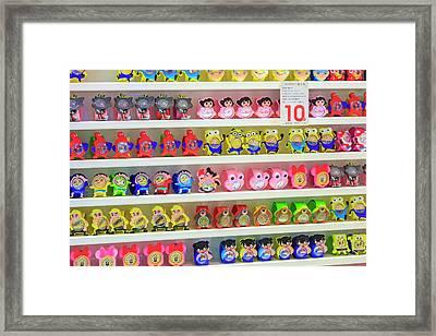 Shelves Of Children Toys, Shops Framed Print by Stuart Westmorland
