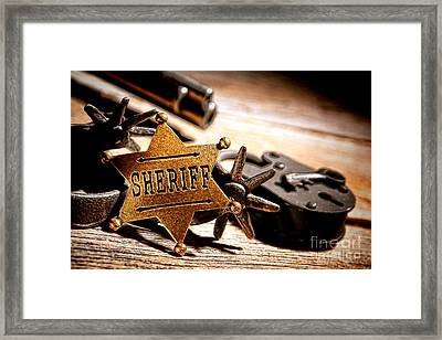 Sheriff Tools Framed Print by Olivier Le Queinec
