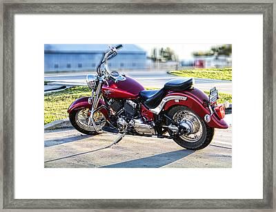 Shinny Red Bike Framed Print by Linda Phelps