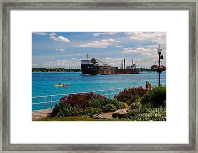 Ship And Kayaks Framed Print