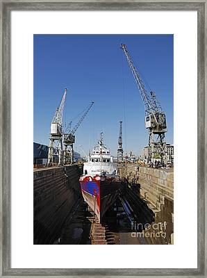 Ship Being Repaint In Dry Dock Framed Print