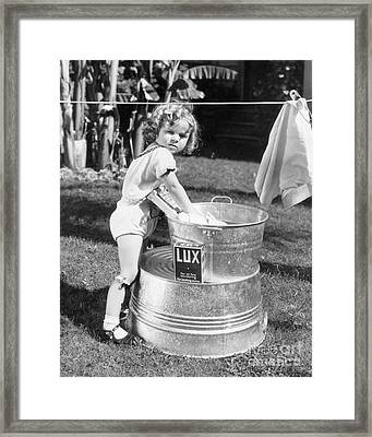 Shirley Temple Washing Clothes Framed Print by MMG Archives