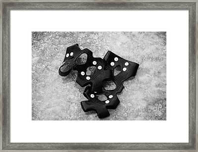 Shoe Spiked Grips On Melting Ice And Snow On Street Surface Framed Print by Joe Fox