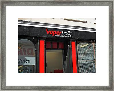 Shop Selling Electronic Cigarettes Framed Print by Robert Brook