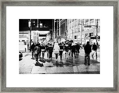 shoppers crossing corner of granville and west georgia streets at night Vancouver BC Canada Framed Print by Joe Fox