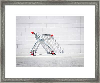 Shopping Cart Against White Wall Framed Print by Glenn Homann / Eyeem
