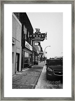 shops and stores on the main street Biggar Saskatchewan Canada in winte Framed Print by Joe Fox