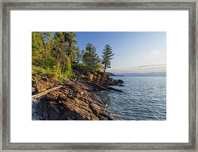 Shoreline Of Flathead Lake Receives Framed Print by Chuck Haney