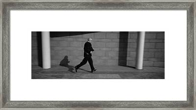 Side Profile Of A Businessman Running Framed Print by Panoramic Images