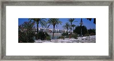 Sidewalk Cafe At The Riverside Framed Print by Panoramic Images