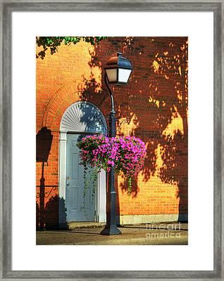 Sidewalk Shadows Framed Print