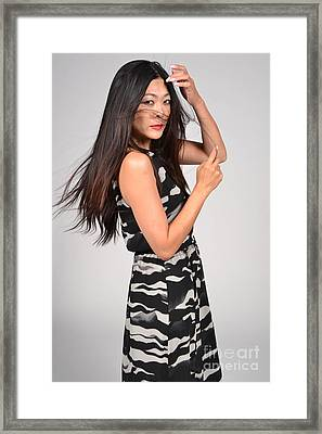 Sideways Glance Female Asian Model Framed Print by Heather Kirk