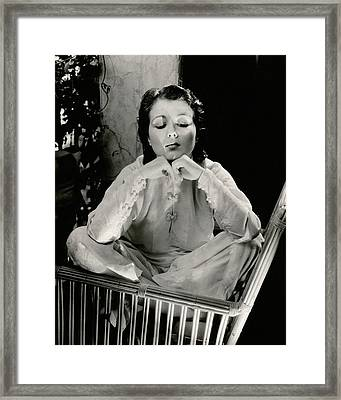 Sidney Fox Sitting On A Bamboo Chair Framed Print by Edward Steichen