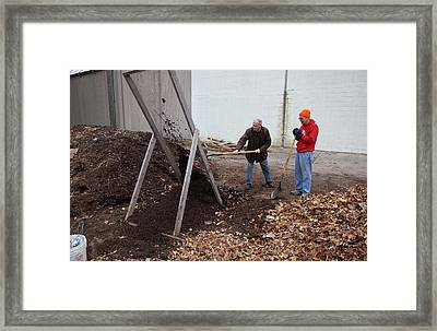 Sifting Compost Through A Screen Framed Print by Jim West