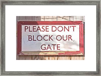 Sign On Gate Framed Print by Tom Gowanlock