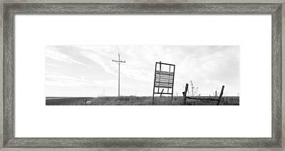 Signboard In The Field, Manhattan Framed Print