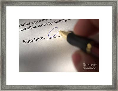 Signing Away Framed Print