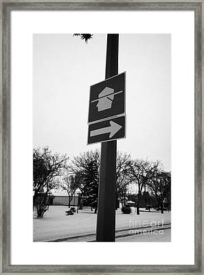 signpost for rcmp royal canadian mounted police station in small town of Kamsack Saskatchewan Canada Framed Print