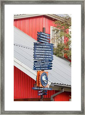 Signposts With Distances To World Cities Framed Print by Ashley Cooper