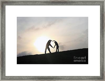 Silhouette Couple Forming A Heart Framed Print by Lars Ruecker
