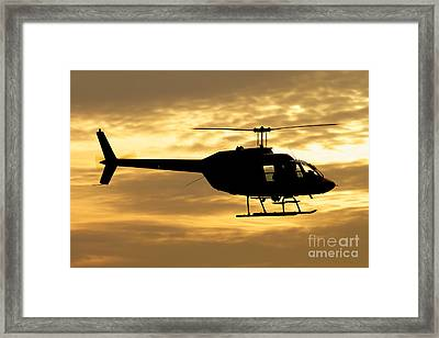 Silhouette Of A Bell 206 Utility Framed Print by Luca Nicolotti