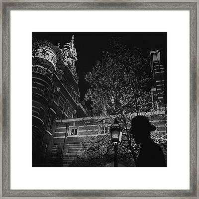 Silhouette Of A British Policeman At Night Framed Print