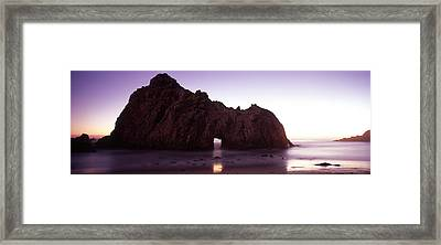 Silhouette Of A Cliff On The Beach Framed Print by Panoramic Images