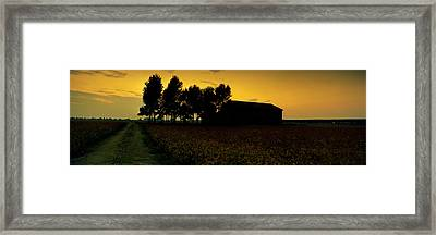 Silhouette Of A Farmhouse At Sunset Framed Print by Panoramic Images