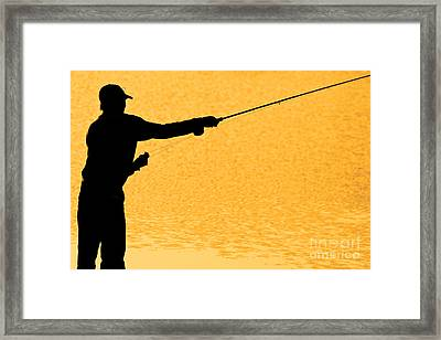 Silhouette Of A Fisherman Holding A Fishing Pole Gold Framed Print