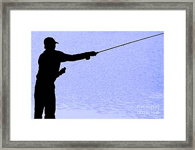 Silhouette Of A Fisherman Holding A Fishing Pole Framed Print
