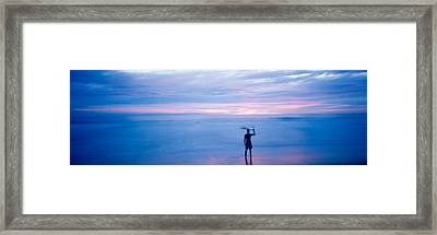 Silhouette Of A Man Carrying Framed Print by Panoramic Images