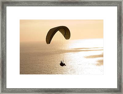 Silhouette Of A Paraglider Flying Framed Print