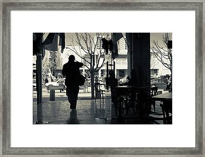 Silhouette Of A Person At Cafe Framed Print