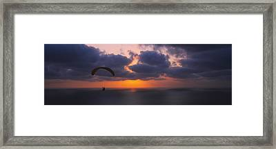Silhouette Of A Person Paragliding Framed Print by Panoramic Images