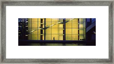 Silhouette Of A Person Walking In Front Framed Print by Panoramic Images