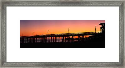 Silhouette Of A Pier At Sunset Framed Print by Panoramic Images