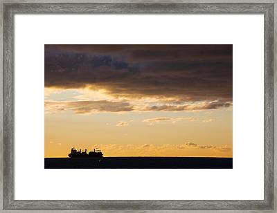 Silhouette Of A Ship In The Sea Framed Print by Panoramic Images
