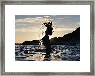 Silhouette Of A Woman In Waist-deep Framed Print by Ben Welsh