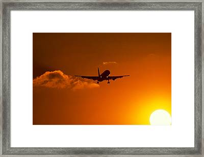 Silhouette Of Airliner In Golden Sunset Framed Print by Panoramic Images